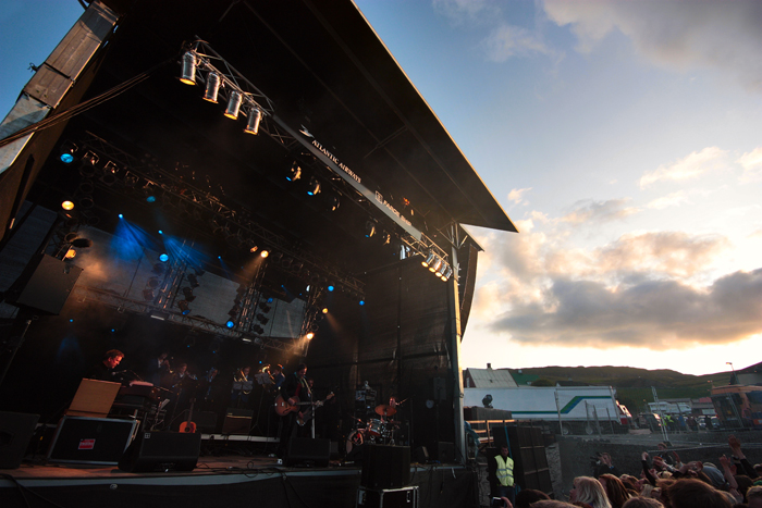 Teitur on stage at the G! Festival. Sunset in the background!