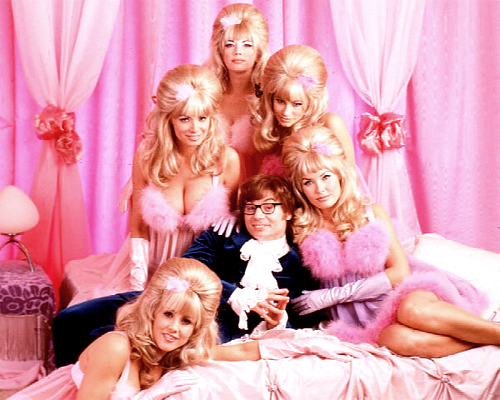 Austin Powers and his beautiful, clad-all-in-pink Fembots.
