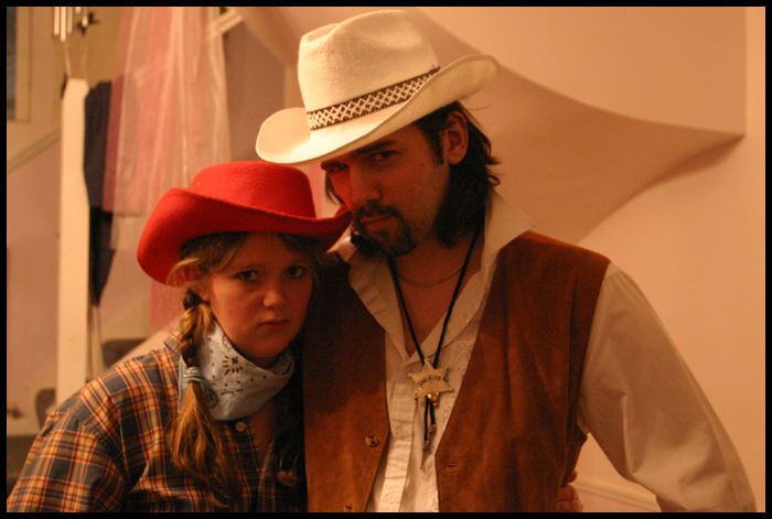 Sherif Sebastian and his younger sister. Posing as... cowboys.
