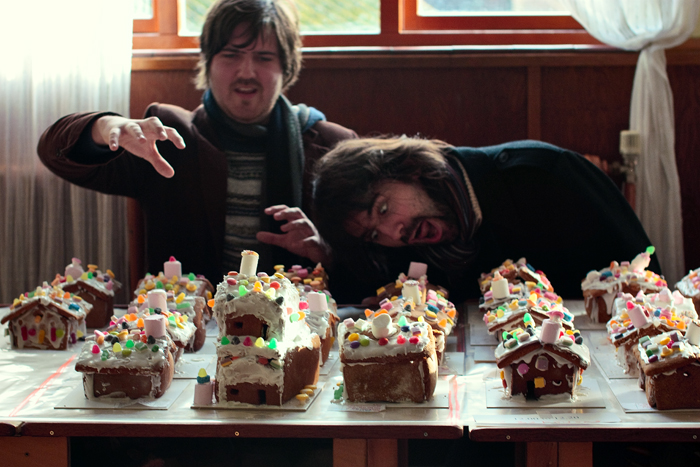 There was a room with about 100 gingerbread houses, all waiting for their icing to dry...
