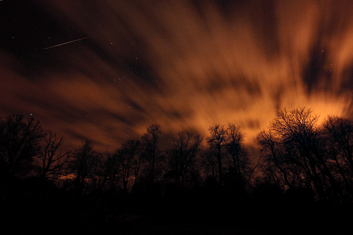 A meteor, and the scary, 'apocalyptic' look of light pollution on clouds racing high above.