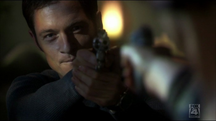 OK, Tahmoh looks pretty hot with a gun. But that's the only time he looks hot.