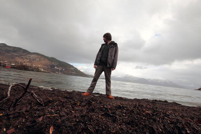 Seb, standing by Hardanger Fjord, Strandebarm in Norway